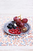 Pomegranate seeds,blueberries and grapes
