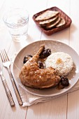 Chicken leg with rice and prunes