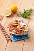 Prawn skewers with lemon, ginger and coconut oil