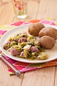 Stewed leeks with chipolatas,boiled potatoes