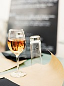Glass of rosé on a restaurant table