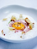 Garlic soup,egg yolk and horse mackerel with croutons and coarse salt