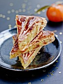 A stack of three slices of clementine galette