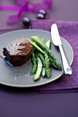Thick doe fillet glazed in wine sauce, crisp green asparagus