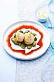Scallops with zucchinis and sprinkled with paprika