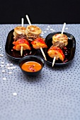 White sausage, morel and lobster brochettes, red hot pepper sauce