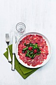 Beef carpaccio with raspberry vinaigar and pine nuts