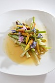 Plate of mini vegetables with edible flowers