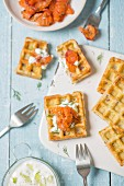 Waffles garnished with gravlax salmon