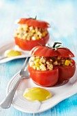 Tomatoes stuffed with paté,diced hard-boiled eggs and capers,curry and mustard-flavored mayonnaise