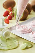Making meringue roses with a piping bag