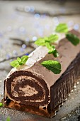 Chocolate and tea jelly log cake decorated with After Eights