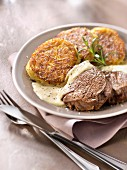 Thick beef fillet with mustard sauce and potato patties