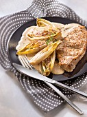 Veal chop with braised chicory and creamy cider sauce