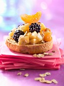 Apple,blackberry and apricot on toast