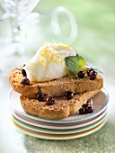 Granary biscottes garnished with lemon mousse and frosted blueberries