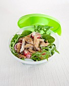 Take-away rocket lettuce,spinach,tomato and smoked turkey salad in white dressing