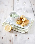 White fish fingers with green sauce