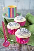 Cupcakes with blackberry frosting