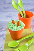 Funny carrot and flower pot cupcake