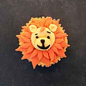 Cupcake decorated with an almond paste lion