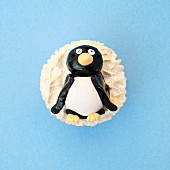 Cupcake topped with a sugar penguin