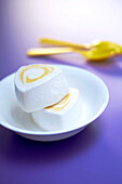 Coconut ice cream mousse with lemon coulis