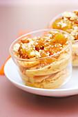 Praline ice cream with caramelized apples and broken amarettis