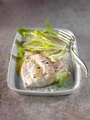 Royal sea bream fillet with butter sauce and thinly sliced fennel