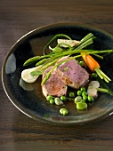 Veal filet mignon with spring vegetables