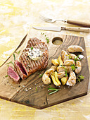 Grilled entrecote of beef, herb butter and salt potatoes