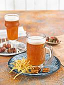 Aperitif atmosphere with beer mugs