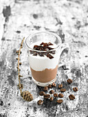 Cup of chocolate mousse, whipped cream and coffee gelatine