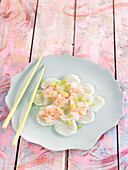 Scallop and shrimp carpaccio with lime zest