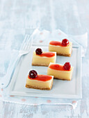 Lemon-mint jelly bites and red fruit coulis