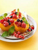 Peaches garnished with summer fruit