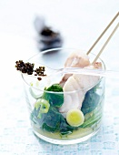 Mini fish brochettes with caviar and fresh spinach