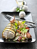 Roasted hake wrapped in zucchini strips with garlic,mixed salad with herb vinaigrette