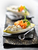 Crisp chicory leaves garnished with ricotta, dill and smoked salmon