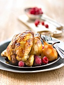 Roasted young cockerel with pears and raspberries