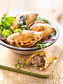 Small ground beef and red onion pies