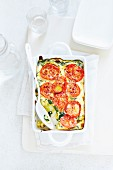 Clafoutis with spinach pasta and tomatoes