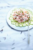 Salmon tatar with cream cheese on cucumber carpaccio