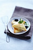 Brick pastry parcels with goat's cheese and olives