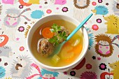 Vegetable broth with meatballs
