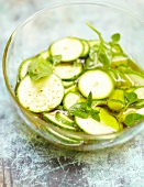 Sliced zucchinis marinated in oil and basil