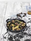 Rigatonis with squid and black trumpet mushrooms