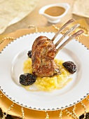 Sweet and sour grilled lamb chop, apple sauce and prunes