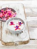 Yoghurt with Magellan fuchsia flowers