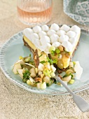 Slice of nutty gorgonzola cheesecake, celery, grape, pear and parmesan salad
